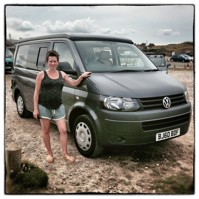 Nicola Rousseau from Surrey poses for a photograph besides her 2010 fifth generation T5, Volkswagen Transporter van near Newquay on August 8, 2014 in Cornwall, England. The van, which was converted to a camper van this year is normally on hire through Nicola's company Littlefoot Campers. (Photo by Matt Cardy/Getty Images)