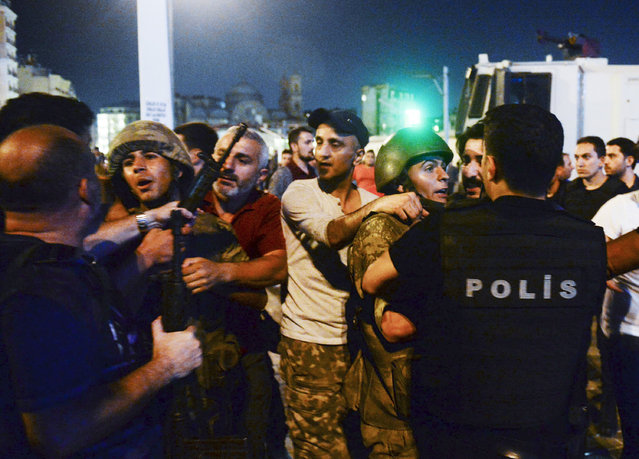 Turkish soldiers, arrested by civilians, are handed to police officers, in Istanbul's Taksim square, early Saturday, July 16, 2016. Members of Turkey's armed forces said they had taken control of the country, but Turkish officials said the coup attempt had been repelled early Saturday morning in a night of violence, according to state-run media. (Photo by Selcuk Samiloglu/AP Photo)