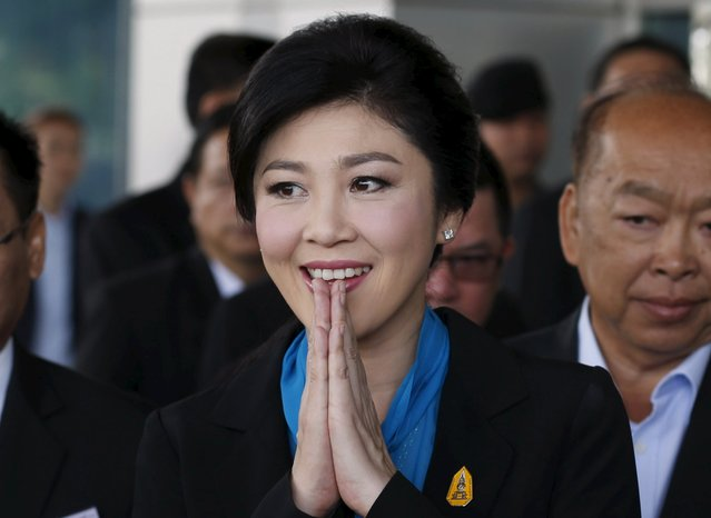 Ousted former Thai Prime Minister Yingluck Shinawatra gestures as she arrives at the Supreme Court in Bangkok, Thailand, August 31, 2015. (Photo by Chaiwat Subprasom/Reuters)