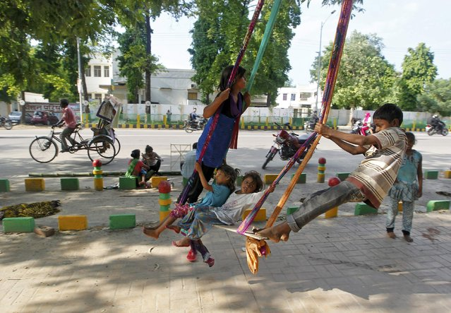 Children play on an improvised swing in Allahabad, India, August 3, 2016. (Photo by Jitendra Prakash/Reuters)