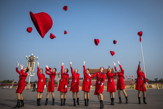 Chinese stewardesses throw their hats as they pose for photographs at Tiananmen Square before the closing ceremony of the 19th National Congress of the Communist Party of China (CPC) at the Great Hall of the People (GHOP) in Beijing, China, 24 October 2017. China holds the 19th Congress of the Communist Party of China, the country's most important political event where the party's leadership is chosen and plans are made for the next five years. (Photo by Roman Pilipey/EPA)