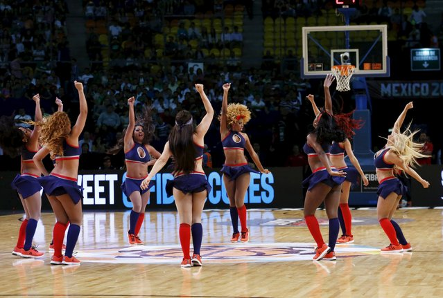 Dancers perform during half-time of the 2015 FIBA Americas Championship semi-final basketball game between Canada and Venezuela at the Sports Palace in Mexico City September 11, 2015. (Photo by Henry Romero/Reuters)