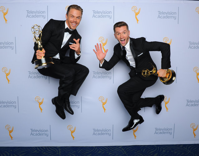 Derek Hough, left, and Travis Wall, winners of the award for outstanding choreography, pose for a portrait at the Television Academy's Creative Arts Emmy Awards at Microsoft Theater on Saturday, September 12, 2015, in Los Angeles. (Photo by Vince Bucci/Invision for the Television Academy/AP Images)