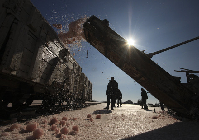 A train is loaded with sea salt at a salt production facility at the Sasyk-Sivash lake near the city of Yevpatoria in Crimea, October 5, 2014. (Photo by Pavel Rebrov/Reuters)