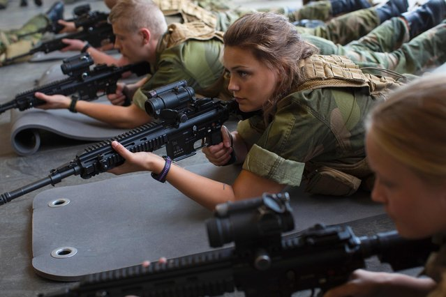 Female army recruits attend a base training at the armored battalion in Setermoen, northern Norway on August 11, 2016. Norway has become the first NATO member to have compulsory conscription for women as well as men in the army. Recently, the first batch of army recruits joined the ranks in The Armored Battalion in the Norwegian Army located in Setermoen in northern Norway. The move will see women from the age of 18 women being drafted in to serve the country's armed forces for a set period of time –sharing everything from equipment, training regimes and even living quarters with their male comrades. It means Norway joins a small set of countries around the world including Israel where national service is compulsory for both sexes. It has been hailed by the country's military chiefs as a way to recruit a wider range of talents. (Photo by Kyrre Lien/AFP Photo)