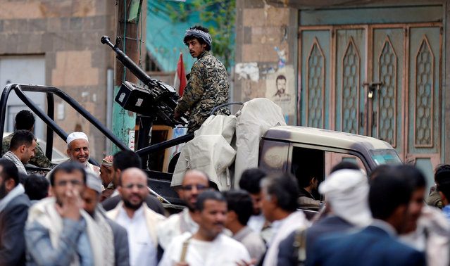 A Houthi militant mans a machine gun mounted on a patrol truck as he secures a vigil marking the anniversary of a double bomb attack inside a mosque during prayers that killed dozens of worshippers in Sanaa, Yemen, September 2, 2016. (Photo by Khaled Abdullah/Reuters)