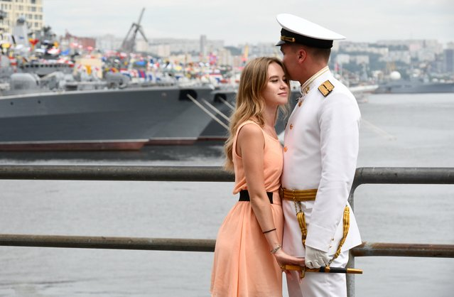 A couple attends the Navy Day celebrations in the far eastern city of Vladivostok, Russia on July 26, 2020. (Photo by Yuri Maltsev/Reuters)