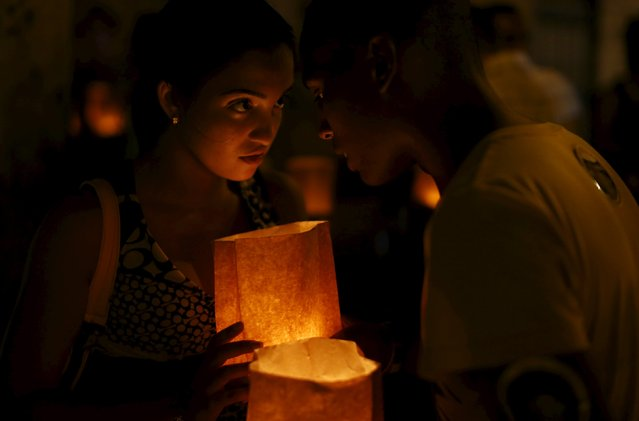 Catholic youths gather during a prayer vigil in front of Havana's cathedral September 18, 2015. (Photo by Carlos Garcia Rawlins/Reuters)
