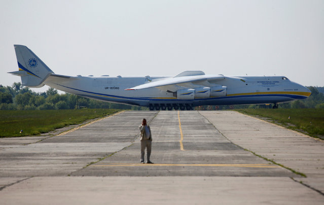 An Antonov An-225 Mriya, a cargo plane which is the world's biggest aircraft, is seen on an airfield before its first commercial flight to the Australian city of Perth in the settlement of Hostomel outside Kiev, Ukraine, May 10, 2016. (Photo by Valentyn Ogirenko/Reuters)
