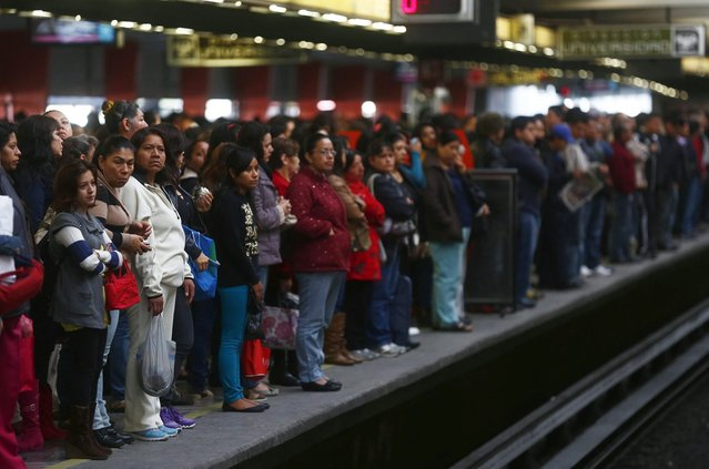 Passengers wait to board the Women-Only passenger car at a subway station in Mexico City October 24, 2014. (Photo by Edgard Garrido/Reuters)