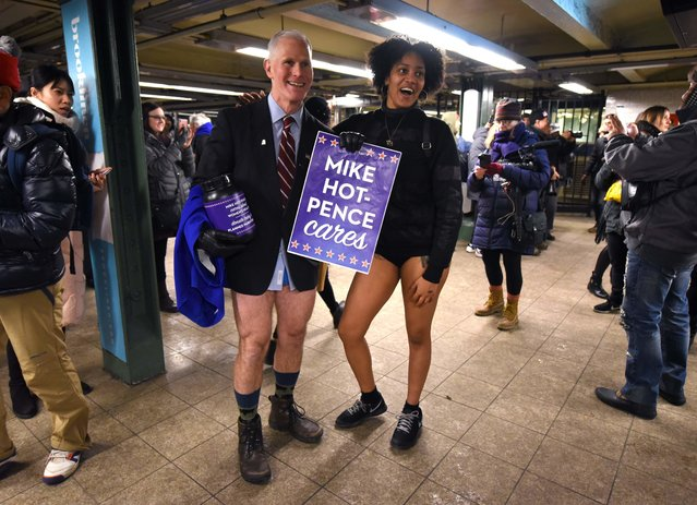 """Participants in the 17 th Annual """"No Pants Subway Ride"""" travel through a New York City subway station on January 7, 2018 in New York. The """"No Pants Subway Ride"""" is an annual event started in 2002 by Improv Everywhere in New York, the goal of which is for riders ride the subway train dressed in normal winter clothes without pants while keeping a straight face. (Photo by Timothy A. Clary/AFP Photo)"""