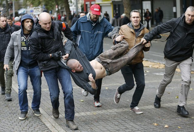 A demonstrator is carried away by plain-clothes police during a march against government reforms and cost-cutting measures in Brussels , October 7, 2015. (Photo by Francois Lenoir/Reuters)