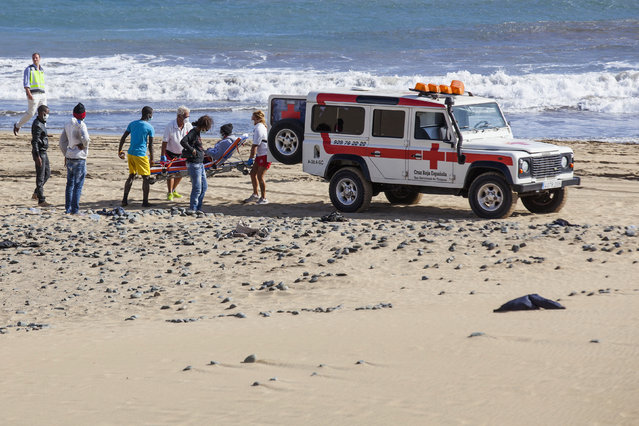 Red Cross members carry a would-be immigrant on a stretcher, to a vehicle at Maspalomas beach on Gran Canaria in Spain's Canary Islands. (Photo by Borja Suarez/Reuters)