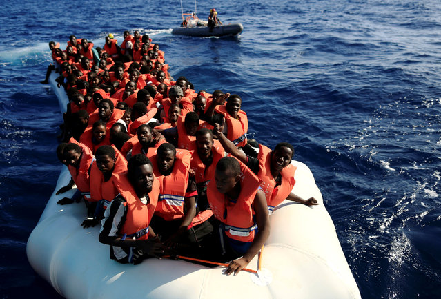 An overcrowded dinghy with migrants from different African countries is followed by members of the German NGO Jugend Rettet as they approach the Iuventa vessel during a rescue operation, off the Libyan coast in the Mediterranean Sea  September 21, 2016. (Photo by Zohra Bensemra/Reuters)