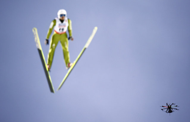 A drone flies next to a pre jumper during the men's large hill individual ski jumping event at the Nordic World Ski Championships in Falun, Sweden, February 26, 2015. (Photo by Kai Pfaffenbach/Reuters)