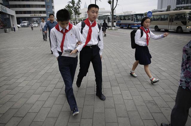 North Korean school children make their way to school on Wednesday, September 28, 2016, in Pyongyang, North Korea. (Photo by Wong Maye-E/AP Photo)