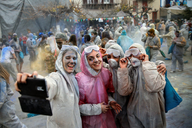 "Revellers celebrate ""Ash Monday"" by participating in a colourful ""flour war"", a traditional festivity marking the end of the carnival season and the start of the 40-day Lent period until the Orthodox Easter, in Galaxidi, Greece February 19, 2018. (Photo by Alkis Konstantinidis/Reuters)"