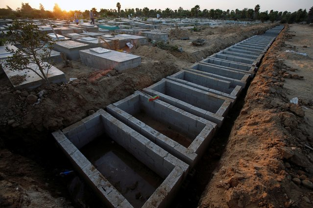 Graves dug for dead people, including the coronavirus disease (COVID-19) victims, are seen at a cemetery, east of Gaza City on September 22, 2020. (Photo by Suhaib Salem/Reuters)