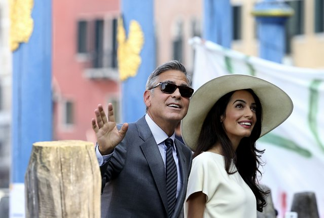 U.S. actor George Clooney and his wife Amal Alamuddin arrive at Venice city hall for a civil ceremony to formalise their wedding in Venice, in this September 29, 2014 file photo. (Photo by Alessandro Bianchi/Reuters)