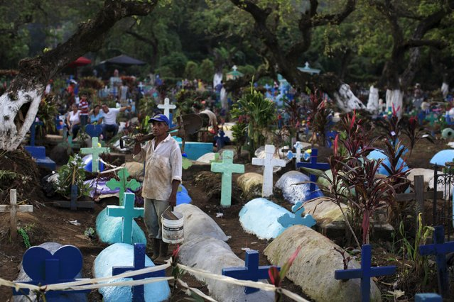 A man stands in a cemetery during All Saints day in Nahuizalco November 1, 2015. (Photo by Jose Cabezas/Reuters)