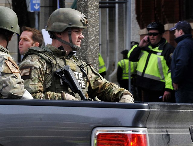 Armed Massachusetts State Police roll into the area following the explosions. (Photo by Josh Reynolds/Associated Press)