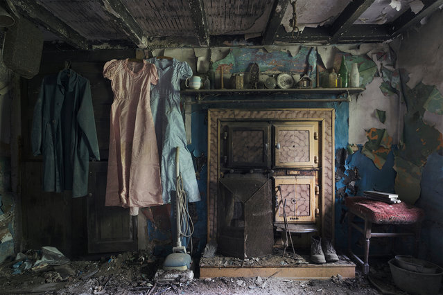 Shortlisted: Welsh Farmhouse. A deserted farmhouse in Wales. The ceilings are caving in but the room is filled with a family's history. (Photo by Ian M. Hazeldine/Historic Photographer of the Year 2020)