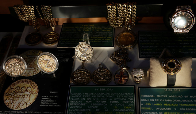 Medals of the Zetas drug cartel and items that once belonged to drug traffickers are displayed in the Drugs Museum, used by the military to showcase to soldiers the lifestyles of Mexican drug lords, at the headquarters of the Ministry of Defense in Mexico City, October 14, 2016. (Photo by Henry Romero/Reuters)