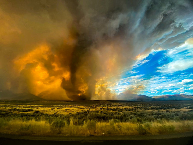 A funnel in the Loyalton Fire in California on Saturday, August 15, 2020. Fire tornadoes spawn in a combination of extreme heat from fire, turbulent winds and uneven terrain, a meteorologist said. (Photo by Katelynn Hewlett/Reuters)