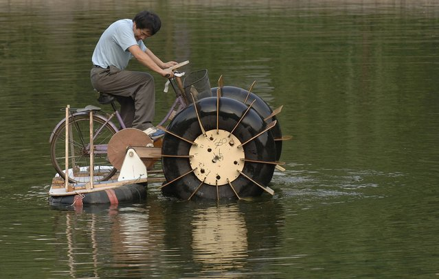 Li Zhiyuan rides a paddle boat made of a bicycle and recycled materials at a park in Hefei, China. Li, the designer of the paddle boat, spent one month making it using a bicycle, trashed wood and tyres. It cost him less than 20 dollars. China is the world's largest garbage importer. In 2008, the U.S. exported 11.6 million tons of recovered paper and cardboard to China. Chinese consumption simply doesn't produce enough waste to feed the country's recycling industry. (Photo by Reuters/Stringer)