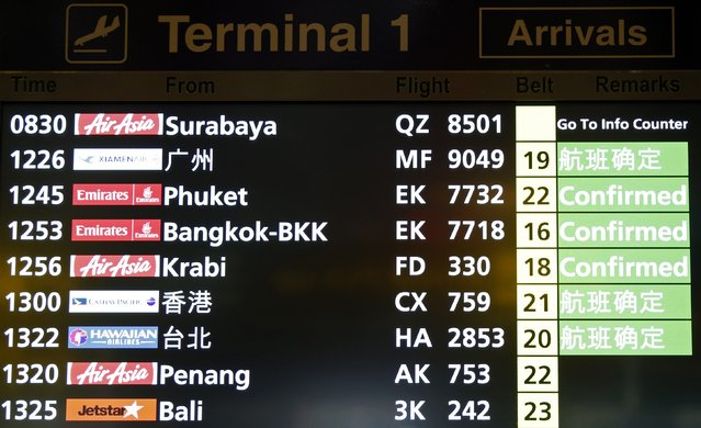 A flight arrival information signboard shows the status of AirAsia flight QZ 8501 from Indonesian city of Surabaya to Singapore at Changi Airport in Singapore December 28, 2014. (Photo by Edgar Su/Reuters)