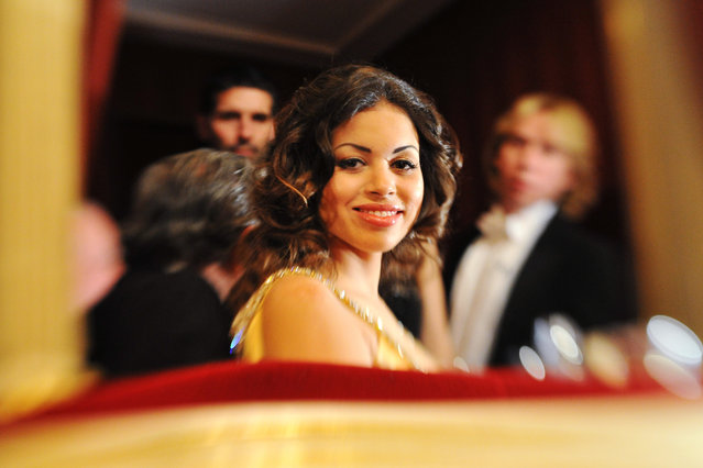 Karima El Mahroug enjoys the company of her host Austrian businessman Richard Lugner during the traditional Opera Ball at the state opera in Vienna on March 3, 2011. Karima el-Mahroug nicknamed Ruby, is the woman at the centre of a s*x scandal which is engulfing Italian Prime Minister Silvio Berlusconi. (Photo by Joe Klamar/AFP Photo)