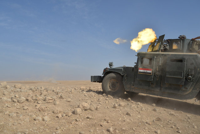 Iraqi security forces military a vehicle is seen during an operation to attack Islamic State militants in Mosul, Iraq, October 21, 2016. (Photo by Reuters/Stringer)