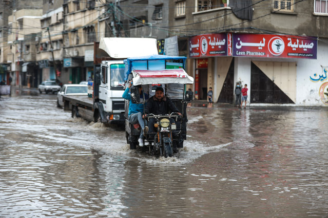 A man riding his motor vehicle makes his way through a flooded street caused by rainfall in Gaza City, Gaza on November 26, 2020 (Photo by Ali Jadallah/Anadolu Agency via Getty Images)