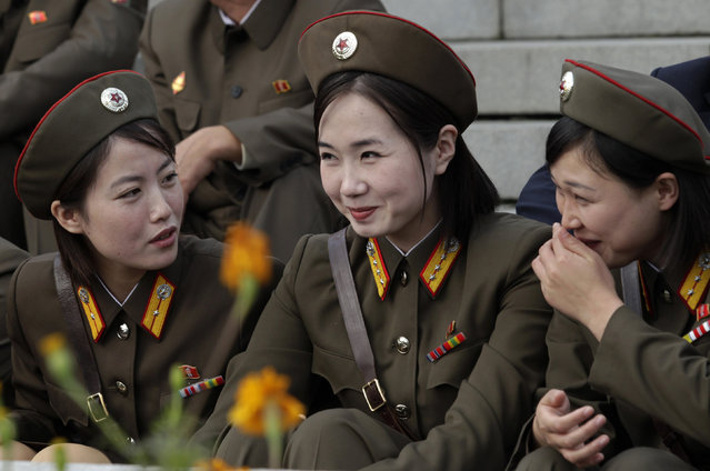 North Korean female soldiers smile before a parade to commemorate the 65th anniversary of the founding of the Workers' Party of Korea in Pyongyang October 10, 2010. (Photo by Petar Kujundzic/Reuters)