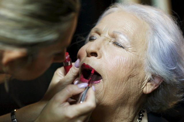 Holocaust survivor Hava Hershkovitz, 82, a previous beauty queen in the competition, has her make-up done during preparations ahead of a beauty contest for survivors of the Nazi genocide in the northern Israeli city of Haifa November 24, 2015. (Photo by Amir Cohen/Reuters)
