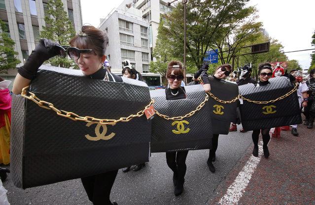 Participants in costumes parade during a Halloween event in Kawasaki, near Tokyo, Sunday, October 30, 2016. (Photo by Shizuo Kambayashi/AP Photo)