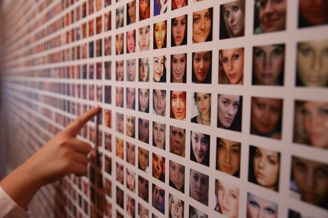 Some of the photographs of a million users of Facebook collated by artists Paolo Cirio and Alessandro Ludovico are displayed at the Big Bang Data exhibition at Somerset House on December 2, 2015 in London, England. (Photo by Peter Macdiarmid/Getty Images for Somerset House)