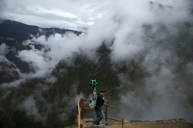 An operator walks carrying the Trekker, a 15-camera device, while mapping the Inca citadel of Machu Picchu for Google Street View in Cuzco, Peru, August 11, 2015. (Photo by Pilar Olivares/Reuters)