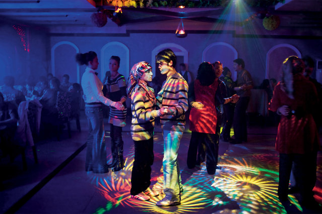 Uighurs socialize at their own nightclubs, in 2009, in Hotan, a Uighur town with a rising Han Chinese population. (Photo by Carolyn Drake/National Geographic)