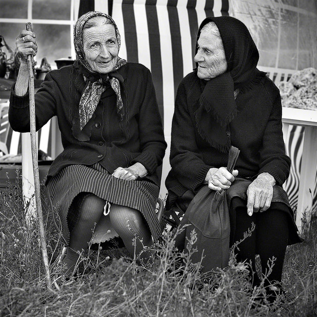 """The Mark of Time"". Two elder women from the village Stoilovo sit down to enjoy the festivities at the annual Zelenika Festival that takes place in the Strandja mountains just outside of Stoilovo. The festival celebrates the flowering of the Strandja Zelenika, a plant that is indigenous to the Strandja mountains. Location: Stoilovo, Bulgaria. (Photo and caption by Daniel Scott/National Geographic Traveler Photo Contest)"