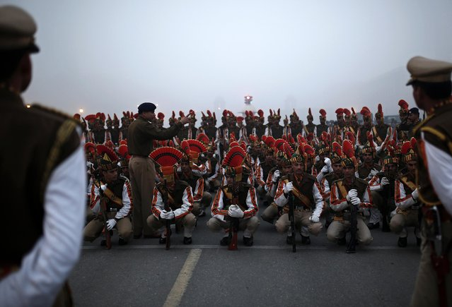 Indian soldiers listen to their instructor during the rehearsal for the Republic Day parade on a foggy winter morning in New Delhi January 16, 2015. (Photo by Ahmad Masood/Reuters)
