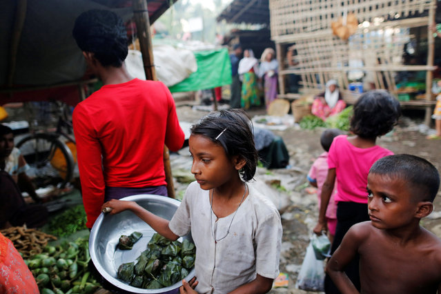 A girl sells food at the internally displaced persons camp for Rohingya people outside Sittwe in the state of Rakhine, Myanmar, November 15, 2016. (Photo by Soe Zeya Tun/Reuters)