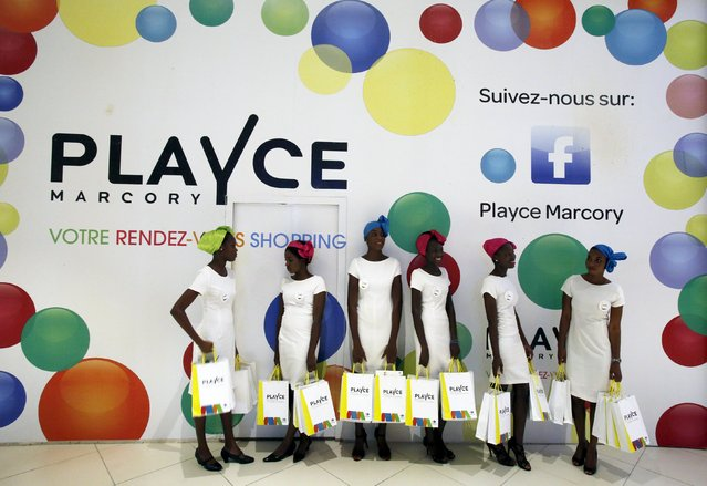 Staff are seen at the PLAYCE mall housing the French supermarket Carrefour after its inauguration by Ivory Coast's President Alassane Ouattara in Abidjan, Ivory Coast, December 18, 2015. French distribution group CFAO opened its first shopping mall in Africa on Friday, the $66 million centre in Ivory Coast's commercial capital Abidjan, as part of a major drive to tap into the growth of Africa's middle classes. (Photo by Thierry Gouegnon/Reuters)