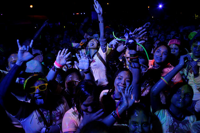 Participants dances after a nocturnal 5K color glow party run in Monterrey, Mexico November 19, 2016. Pictures taken on November 19, 2016. (Photo by Daniel Becerril/Reuters)