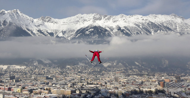 Norway's AndersJacobsen soars during the trial jump at the third stage of the four hills ski jumping tournament in Innsbruck, Austria, Saturday, January 3, 2015. (Photo by Matthias Schrader/AP Photo)
