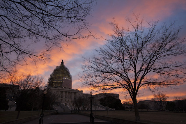 A palette of pinks and blues paint the morning sky behind the U.S. Capitol in Washington, Tuesday, February 3, 2015. (Photo by J. Scott Applewhite/AP Photo)