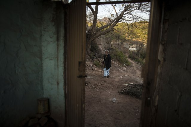A man stands outside his house on the outskirts of Islamabad February 11, 2015. (Photo by Zohra Bensemra/Reuters)