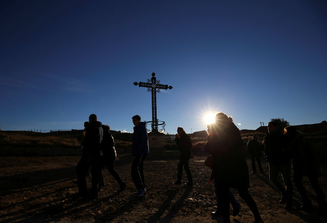 Visitors walk past the Cross for the Fallen in the old village of Belchite, in northern Spain, November 13, 2016. (Photo by Andrea Comas/Reuters)