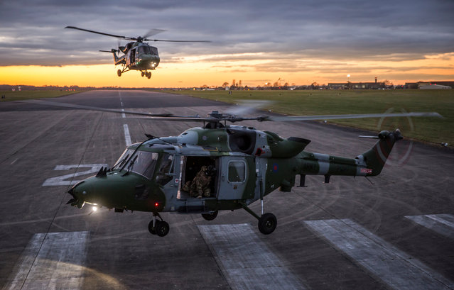 """Lynx sunset"". Photographer of the year, first prize: 657 Sqn Army Air Corps Lynx helicopters land in the sunset at RAF Odiham. (Photo bu Cpl Rob Travis/RAF)"