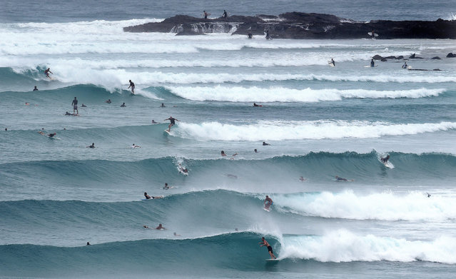 Surfers enjoy the swell courtesy of Tropical Cyclone Marcia at Snapper Rocks on the Gold Coast, Queensland, Australia, 20 February 2015. Tropical cyclone Marcia made landfall near the city of Rockhampton on the north-east coast of Queensland state with gusts of up to 295 kph, media reports said on 20 February. (Photo by Dave Hunt/EPA)